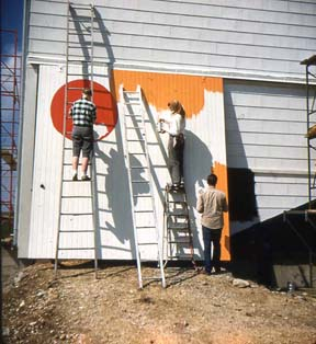 View of the mural on the barn while originally being painted