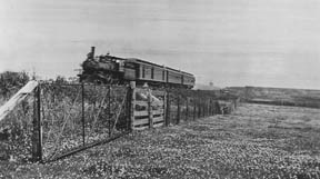 vintage photo of train passing through back pasture